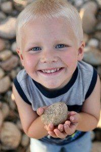 Little Boy Holding Rock